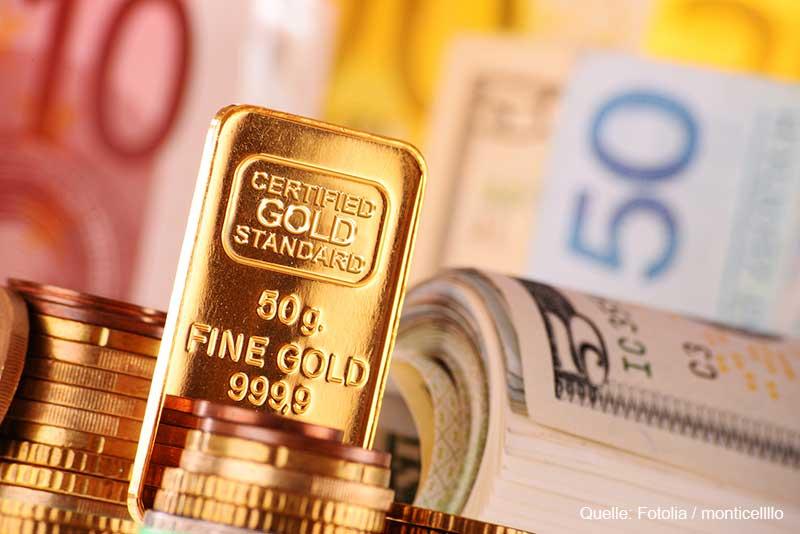 Goldbarren und Geldscheine