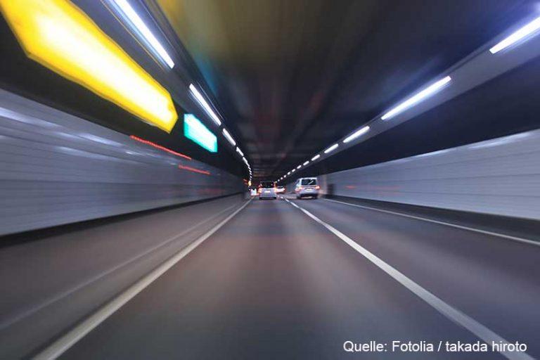 Car traffic in a tunnel , Tokyo highway